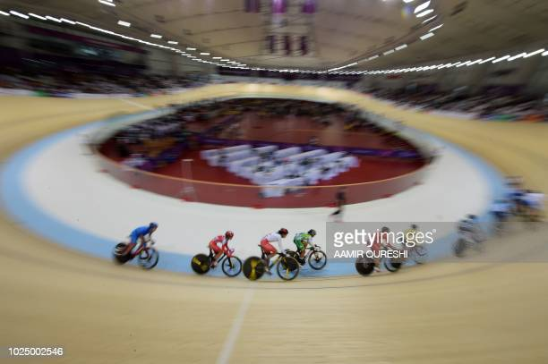 TOPSHOT Riders compete in the women's omnium elimination track cycling event at the 2018 Asian Games in Jakarta on August 29 2018
