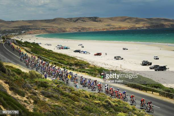 Riders compete past Aldinga Beach during stage five of the 2018 Tour Down Under on January 20 2018 in Adelaide Australia