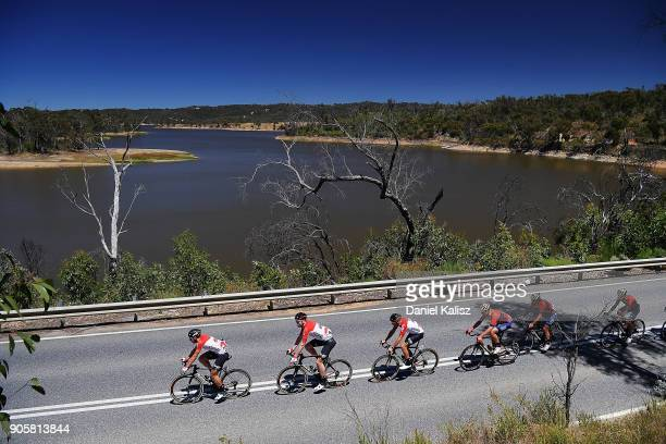 Riders compete past Myponga reservoir during stage two of the 2018 Tour Down Under on January 17 2018 in Adelaide Australia