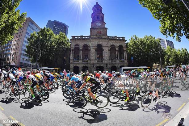 Riders compete past the Adelaide Town Hall during stage two of the 2018 Tour Down Under on January 17 2018 in Adelaide Australia