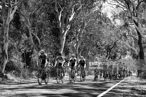 Riders compete through Willunga during stage three of the 2018 Tour Down Under on January 18 2018 in Adelaide Australia