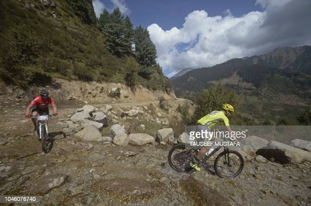 Riders competes in the 14th edition of the Hero MTB Himalaya mountain bike race in the northern Indian state of Himachal Pradesh on October 5 2018...