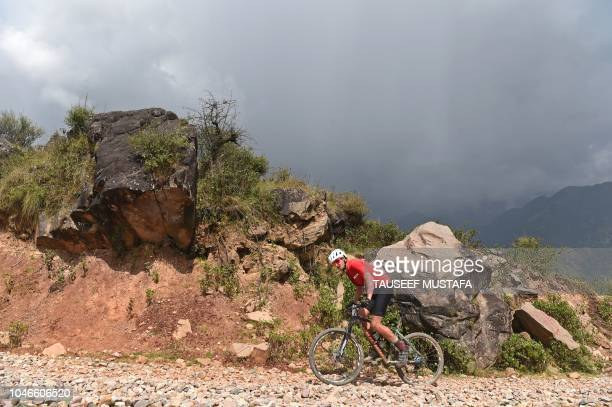 A riders competes in the 14th edition of the Hero MTB Himalaya mountain bike race during a final day at Dharamshala in the northern Indian state of...