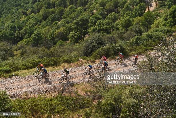 Riders competes in the 14th edition of the Hero MTB Himalaya mountain bike race during a final day at Dharamshala in the northern Indian state of...