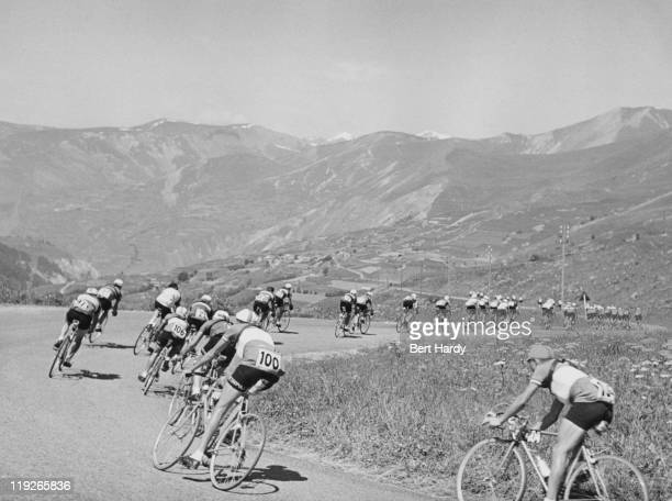 Riders competing in a mountain stage of the Tour de France July 1951 Original publication Picture Post 5381 The Greatest Show On Earth pub 18th...