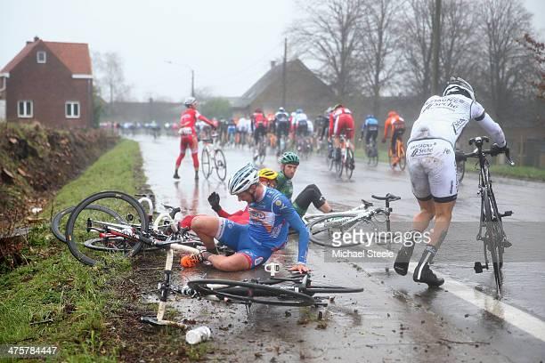 Riders crash in wet conditions during the Omloop Het Nieuwsblad on March 1, 2014 in Ghent, Belgium.