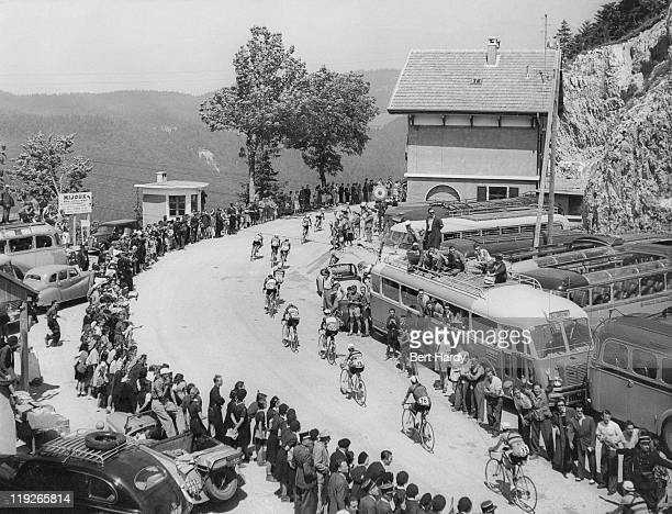Riders cross the border from Switzerland back into France at Mijoux during a mountain stage in the Tour de France July 1951 Original publication...