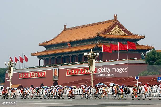 Riders cycle in front of the Tiananmen gate during the Men's Road Cycling event held on the Road Cycling Course during day 1 of the Beijing 2008...