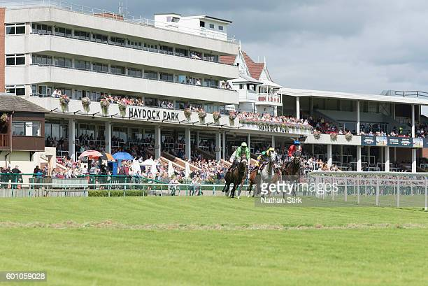 Riders during the ApolloBET Online Casino And Games Handicap at Haydock Park Racecourse on August 4, 2016 in Haydock, England.
