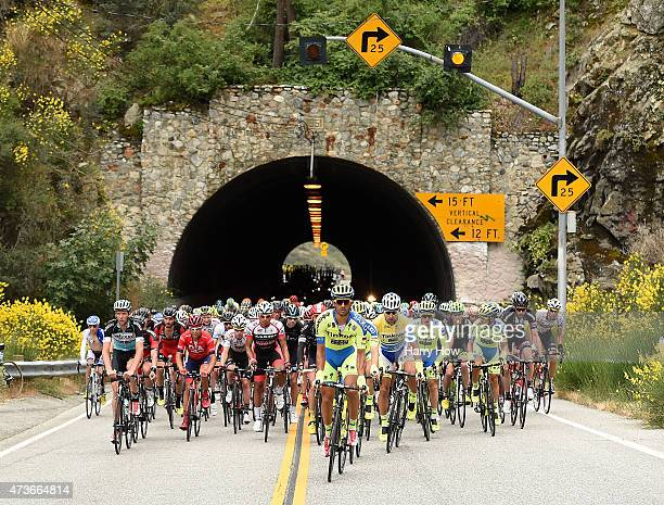 Riders emerge from a tunnel on a climb through Angeles National Forest during stage seven of the 2015 Amgen Tour of California on May 16, 2015 in Los...