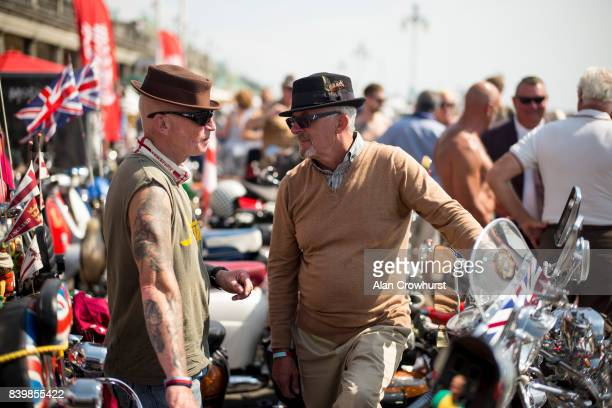 Riders enjoy a chat during The Mod Weekender on August 27 2017 in Brighton England Brighton became the meeting place for Mods on their scooters in...