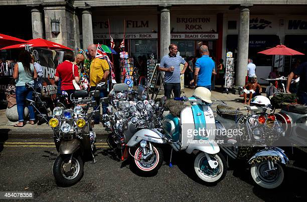 Riders enjoy a drink during the Brighton Mod weekender on August 24 2014 in Brighton England This August Bank holiday will see many Mods and their...