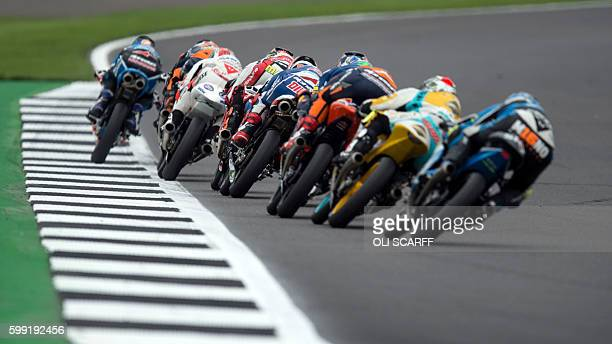 Riders exit Luffield Corner during the Moto3 race at the motorcycling British Grand Prix at Silverstone circuit in Northamptonshire southern England...