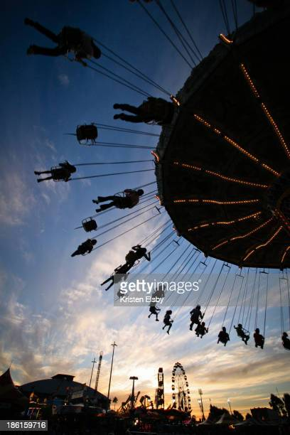 Riders fly high on the 'wave swing' ride at the Sydney Easter Show at Olympic Park, Sydney.
