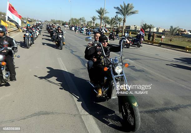 Riders from Baghdad's motorcycle club drive through the Iraqi capital during Baghdad's international marathon on January 29 2016 The 12km marathon is...