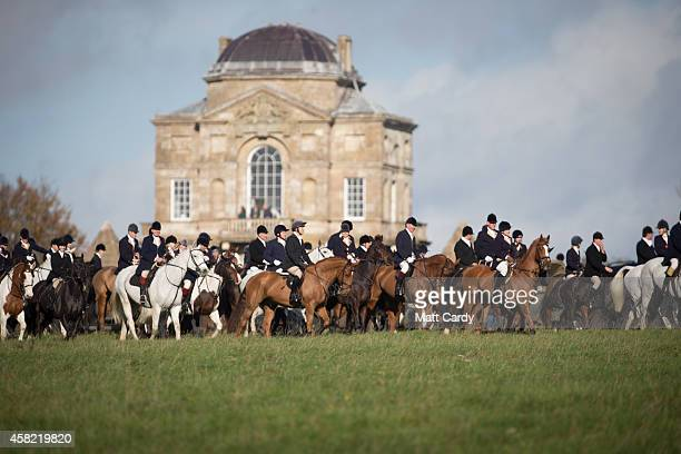 Riders from the Duke of Beaufort's Hunt wait to follow at the opening meet of the season at Worcester Lodge on November 1 2014 near Badminton in...