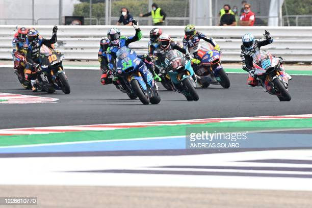 Riders gesture as it starts to rain during the Moto2 race of Emilia Romagna Grand Prix at the Misano World Circuit Marco Simoncelli on September 20,...