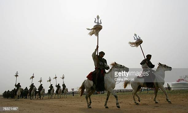 Riders go on stage to attend the horse racing contest during the 12th Nadam Festival at the Saihantala Township on August 23, 2007 in Suniteyou Qi, a...