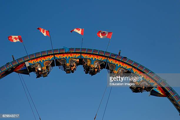 Riders hanging upside down on a roller coaster ride at the CNE Toronto Canada