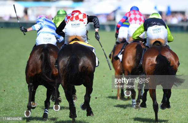 Riders in action using the whip in Race 6, Sovereign Resort Galleywood Hurdle during the Warrnambool Carnival at Warrnambool Racing Club on May 1,...