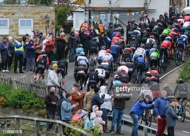 Riders in the peloton begin the climb up Cote Lythe Bank during the men's race on Stage 3 of the Tour de Yorkshire cycling race on May 04 2019 in...