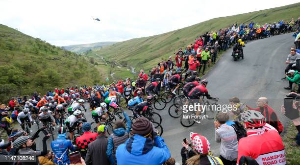 Riders in the peloton climb the Cote de Park Rash ascent near the village of Kettlewell in the Yorkshire Dales during the fourth and final stage of...