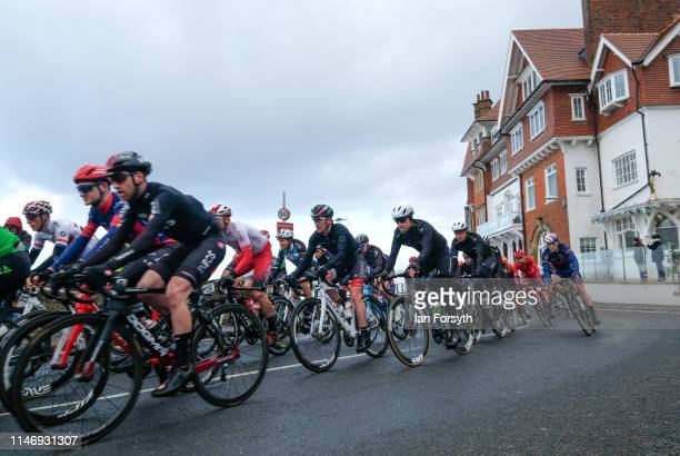 Riders in the peloton in the men's race pass through Sandsend during Stage 3 of the Tour de Yorkshire cycling race on May 04 2019 in Whitby England...