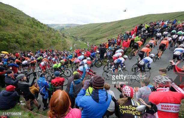 Riders in the peloton tackle the climb on the Cote de Park Rash ascent near the village of Kettlewell in the Yorkshire Dales during the fourth and...