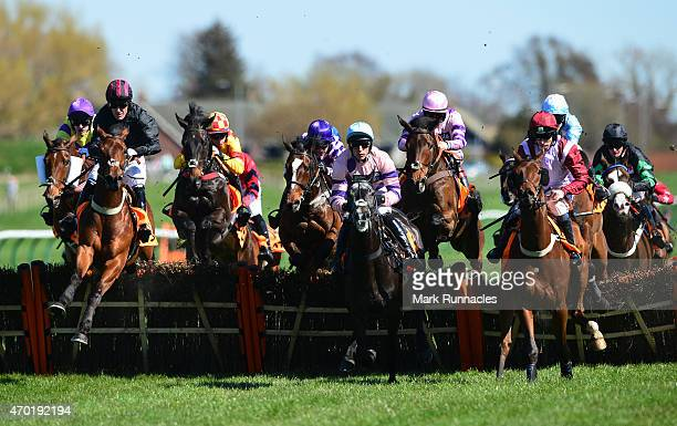 Riders in the QTS Scottish Champion Hurdle Race jump the first fence on the second day of the Scottish Grand National Festival at Ayr Race Course on...