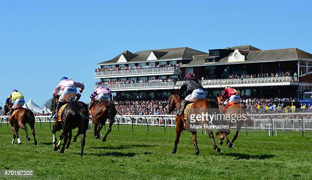 Riders in the QTS Scottish Champion Hurdle Race race past the main stand on the second day of the Scottish Grand National Festival at Ayr Race Course...