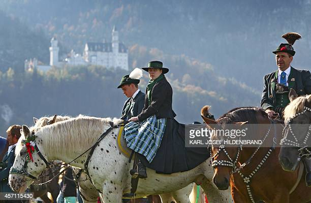Riders in traditional Bavarian dresses sit on their horses as they take part in the Saint Coloman festival on October 12 2014 near Schwangau southern...