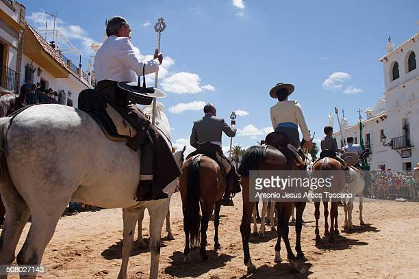 Riders in traditional clothing of flamenco, in the streets of the village of El Rocío, wating to make the presentation in the Chapel of the Virgin....