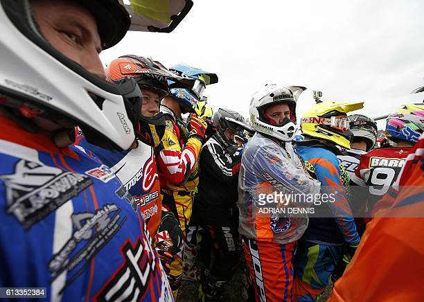 Riders jockey for position at the paddock fence for a running start to their bikes to begin the Adult Quad and Sidecar race at the 2016 HydroGarden...