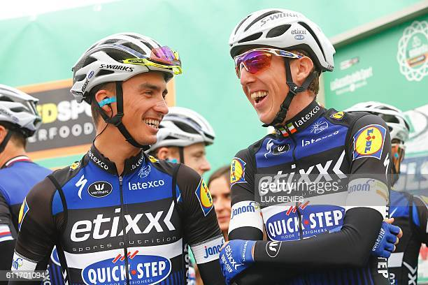 Riders Julian Alaphilippe and Daniel Martin of team Etixx Quick Step chat before the start of the 110th edition of the giro di Lombardia a 241 km...