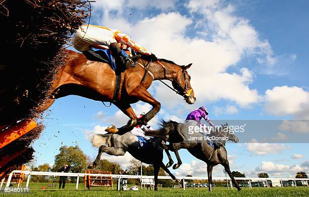 Riders jump over the last during the Juvenile Novices Hurdles Race at Huntingdon Race Course on October 29 2008 in Huntingdon England
