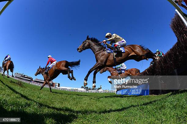 Riders Jump the first fence during the Jordan Electrics Ltd Future Champion Novices Steeple Chase on the second day of the Scottish Grand National...
