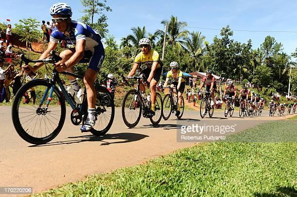 Riders line up during hills climb at the Stage 4 Tour de Singkarak 2013 from Sijunjung - Pulau Punjung, distance 189,5 km. Long and dull natural...