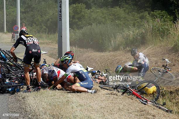 Riders litter the side of the road including Fabian Cancellara of Switzerland riding for Trek Factory Racing in the overall race leader yellow jersey...