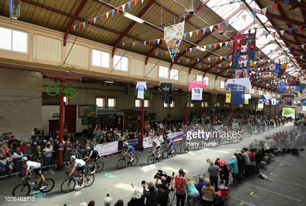 Riders make their way through South Molton Pannier Market during the 15th Tour of Britain 2018 - Stage 2 on September 3, 2018 in South Molton,...