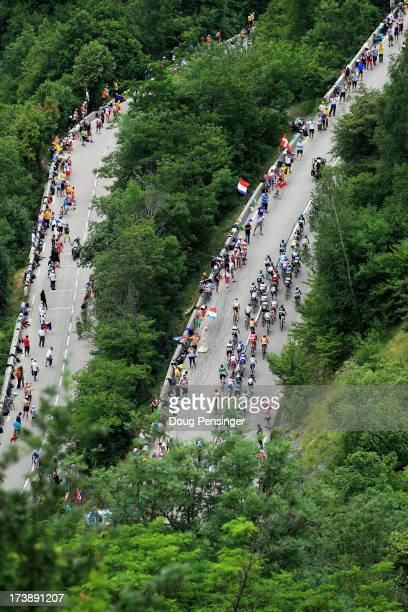 Riders make their way up the final climb during stage eighteen of the 2013 Tour de France a 1725KM road stage from Gap to l'Alpe d'Huez on July 18...