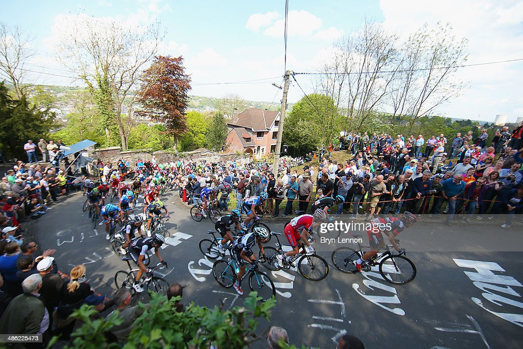 Riders make their way up the Mur de Huy during the 78th edition of the La Fleche Wallonne on April 23, 2014 in Huy, Belgium. The 199km parcours scales the Mur de Huy climb three times, with the final 9.3% average ascent providing the finish to the race.