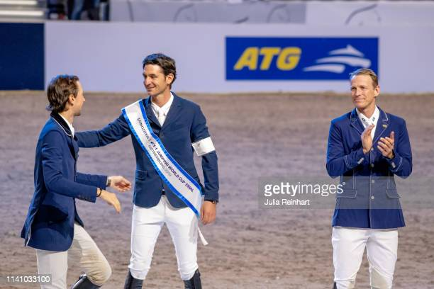 Riders Martin Fuchs Steve Guerdat and Peder Fredricson celebrate during the price giving ceremony for the 2019 Longines FEI Jumping World Cup Final...