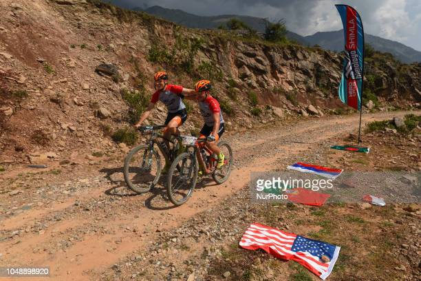 Riders near the finishing point as they compete in the 14th edition of the Hero MTB Himalaya mountain bike race in the northern Indian state of...