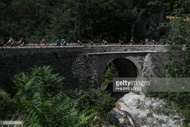 The pack led by Great Britain's Luke Rowe rides during the 14th stage of the 105th edition of the Tour de France cycling race between...