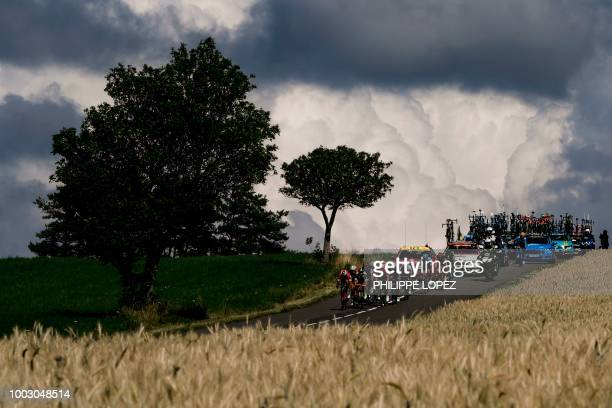 TOPSHOT Riders of a breakaway counter attacking group ride through the Cevennes region during the 14th stage of the 105th edition of the Tour de...