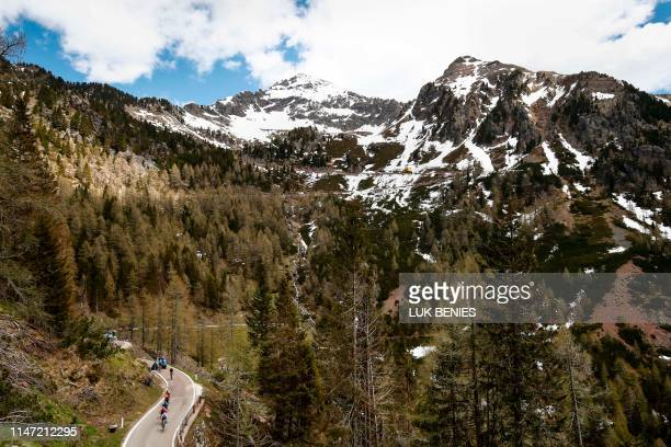 Riders of a breakaway group take the ascent of the Manghen pass during stage twenty of the 102nd Giro d'Italia Tour of Italy cycle race 194kms from...