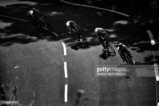 Riders of a breakaway take a curve during the twelfth stage of the 106th edition of the Tour de France cycling race between Toulouse and...