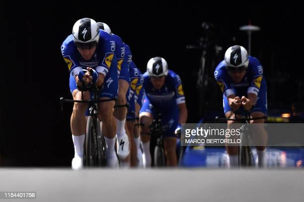Riders of Belgium's Deceuninck-Quick-Step cycling team compete in the second stage of the 106th edition of the Tour de France cycling race, a 27.6km...