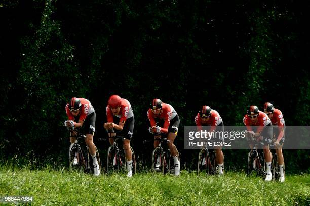 Riders of Belgium's Lotto Soudal cycling team compete during the third stage of the 70th edition of the Criterium du Dauphine cycling race a...