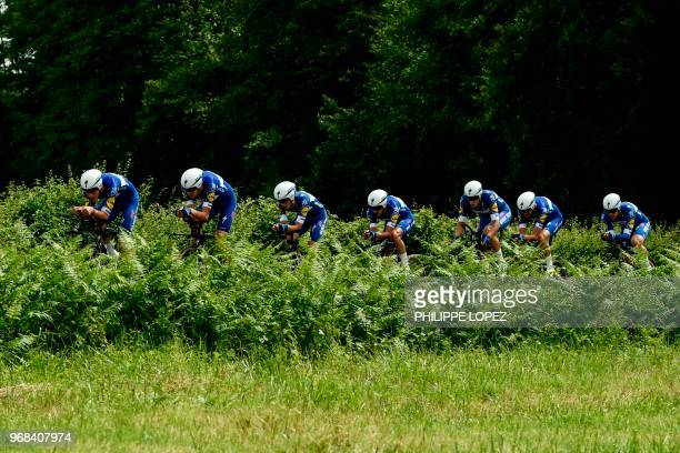 Riders of Belgium's Quick - Step Floors cycling team compete during the third stage of the 70th edition of the Criterium du Dauphine cycling race, a...